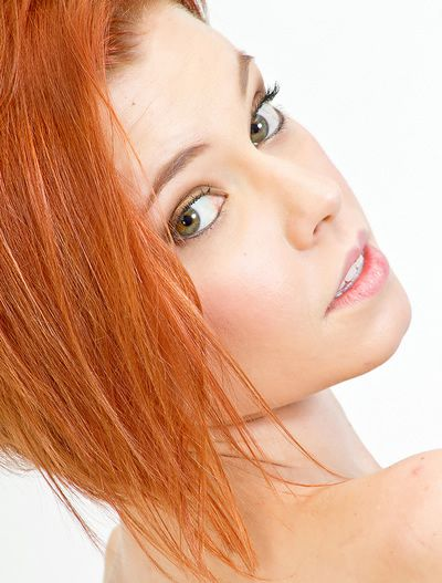 woman with red hair and natural makeup