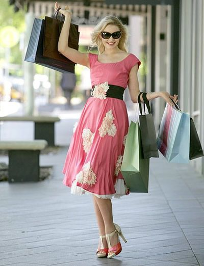 happy woman shopping and feeling free